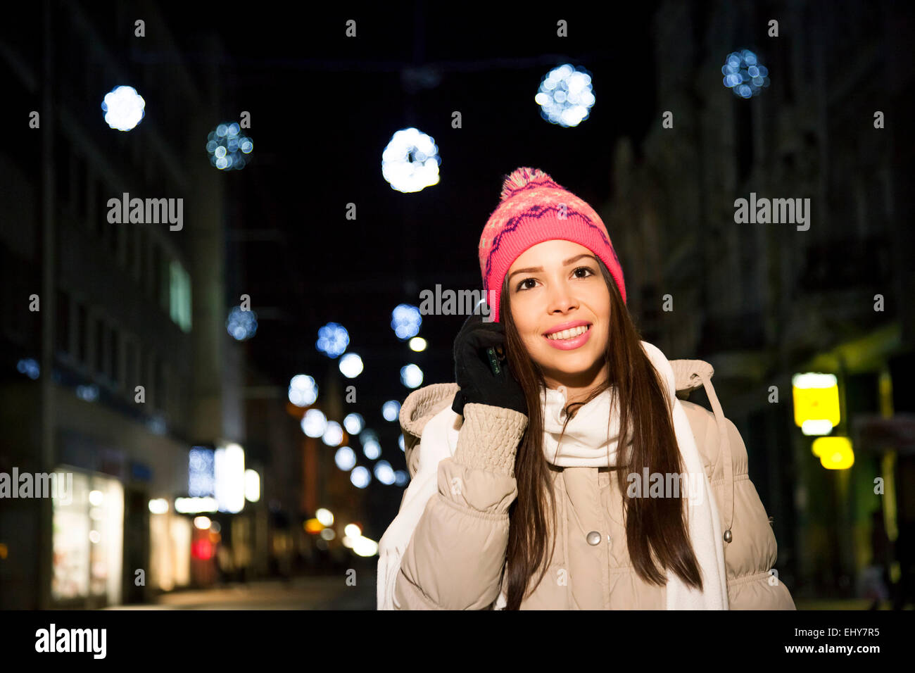Portrait of young woman using smart phone - Stock Image