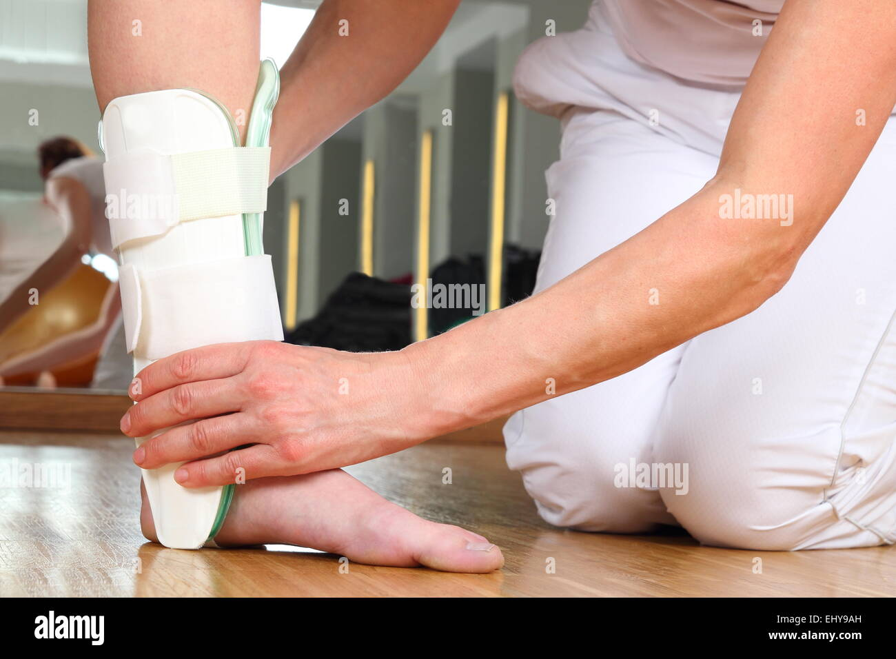 A Orthopedist  with Patient and Ankle orthosis - Stock Image