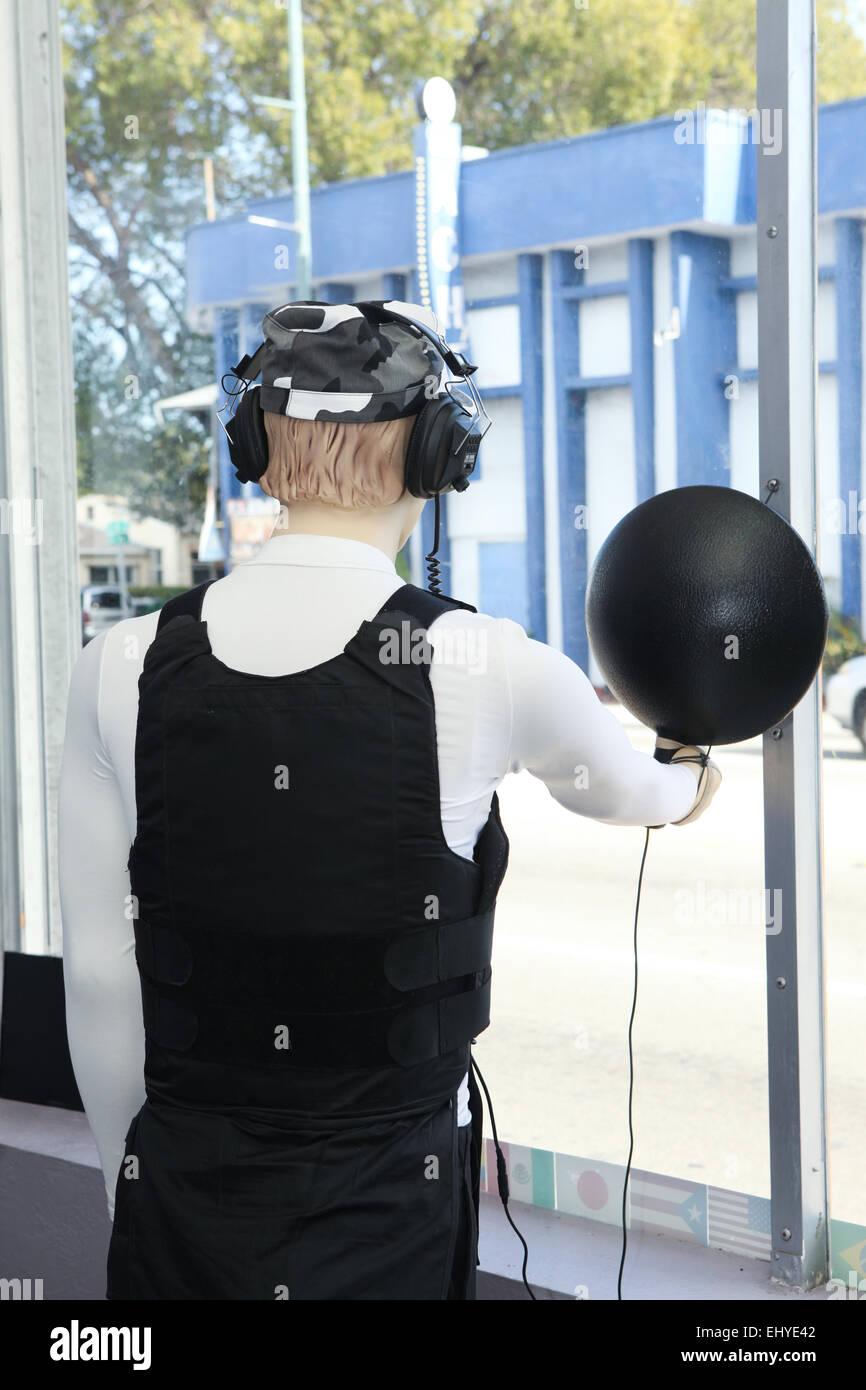 Mannequin, bullet proof vest, radar, military, window, main street, spy, security - Stock Image