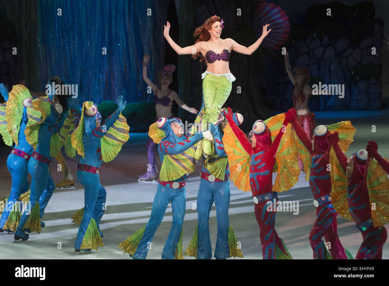 Calgary, Canada. 18th March, 2015. Ariel of Disney's Little Mermaid makes her way on the ice in Disney On Ice - Stock Image