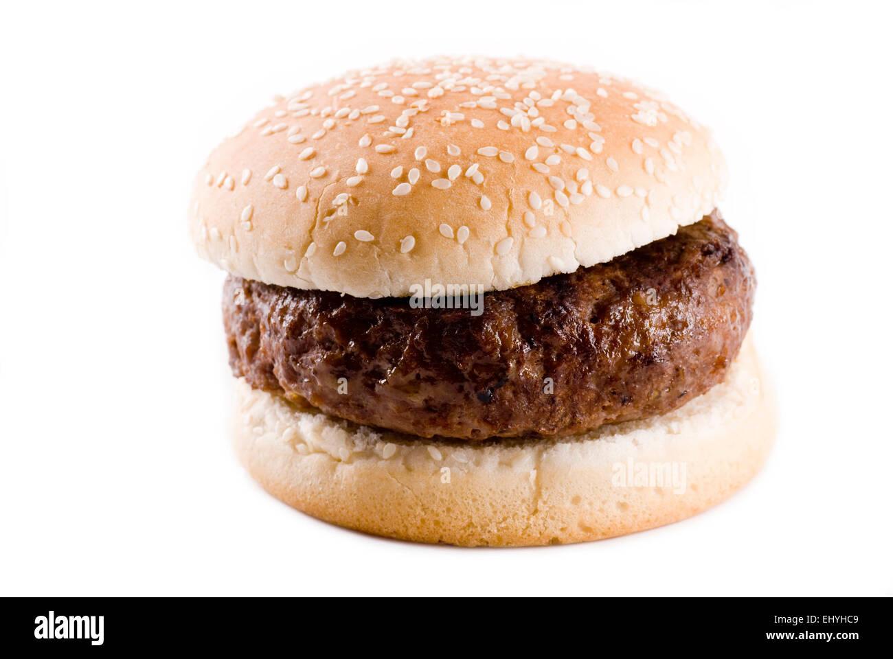 Juicy hamburger close up on white background. - Stock Image