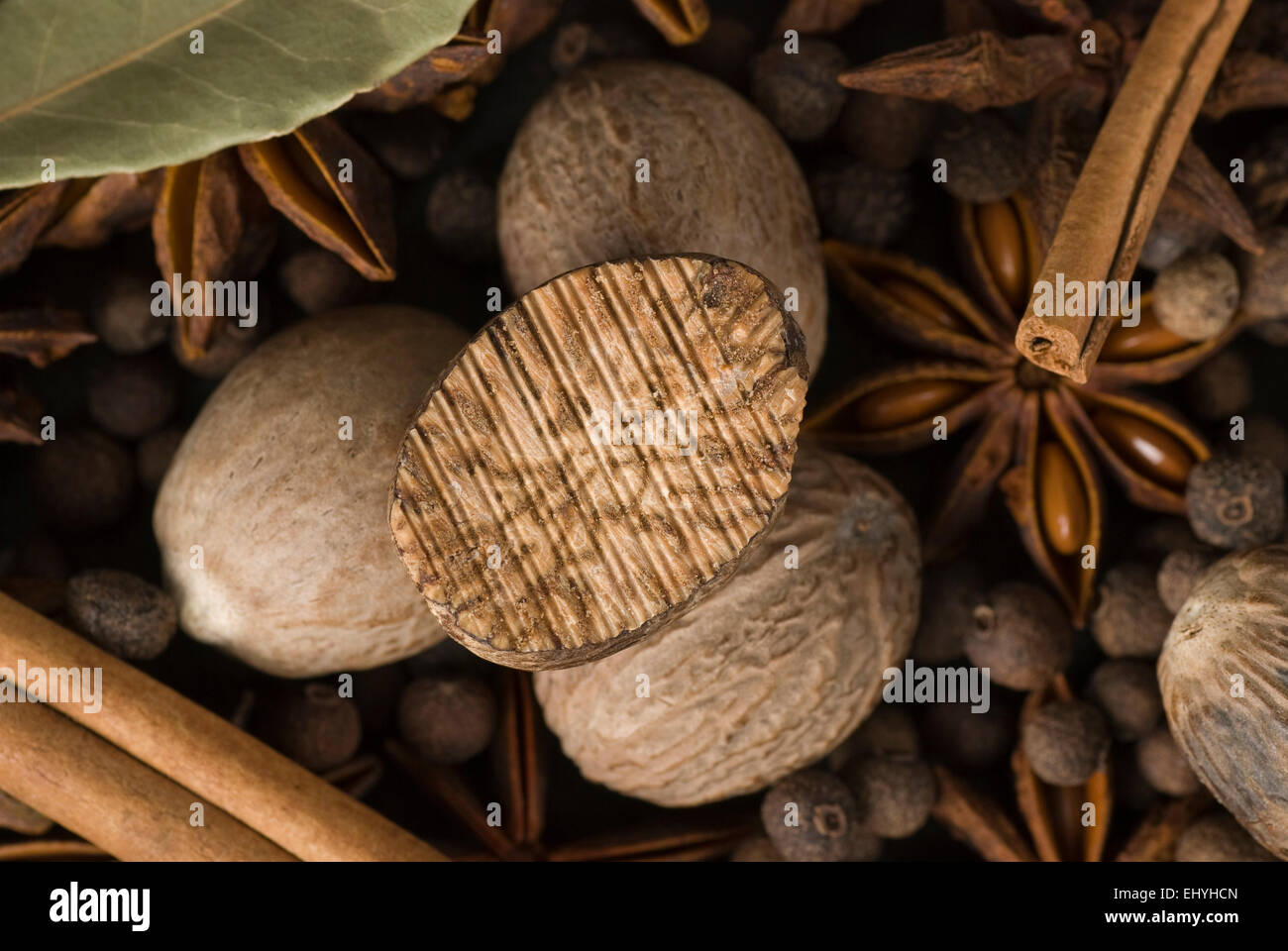 Nutmeg and other spices. - Stock Image