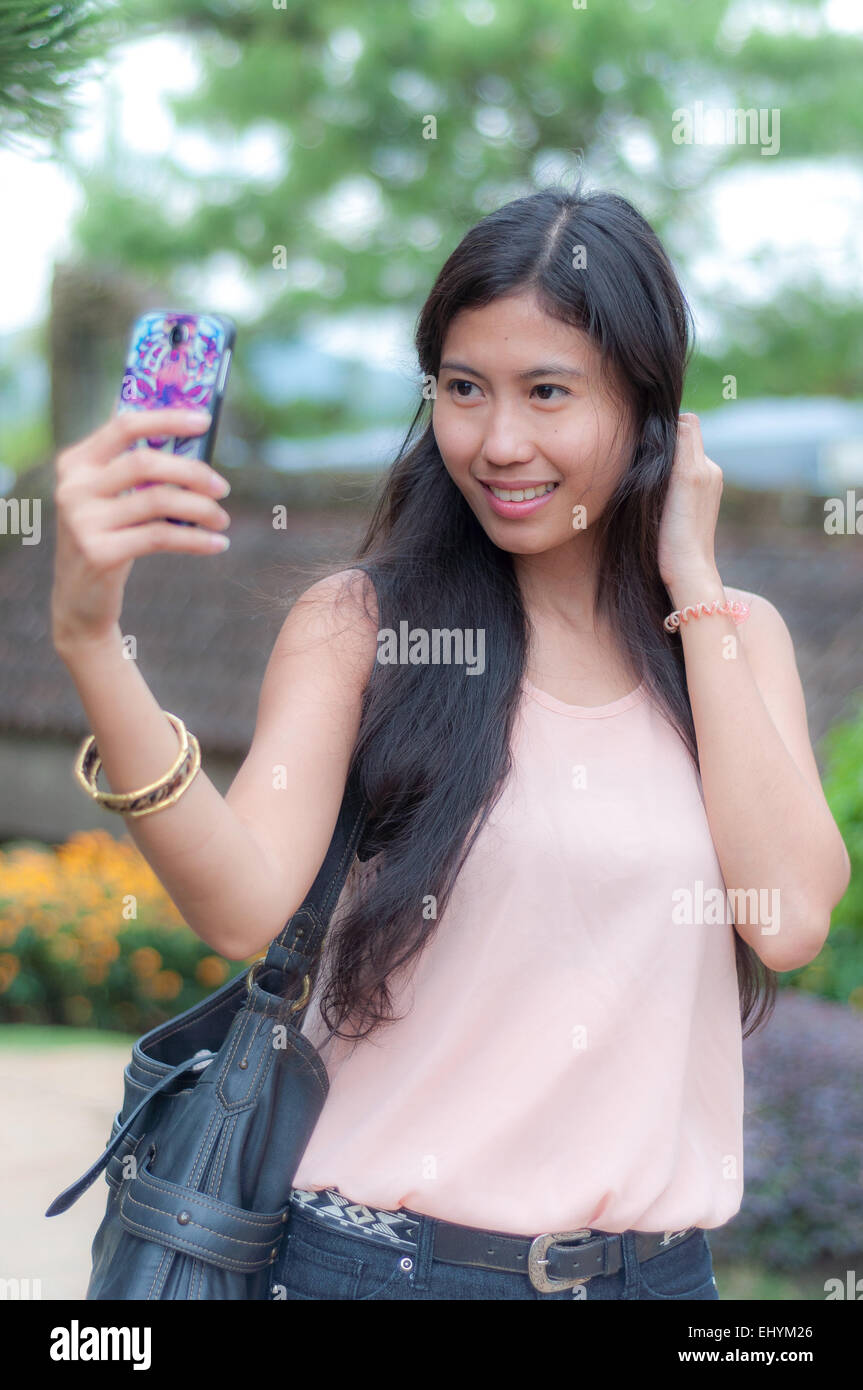 Young Woman taking a selfie - Stock Image