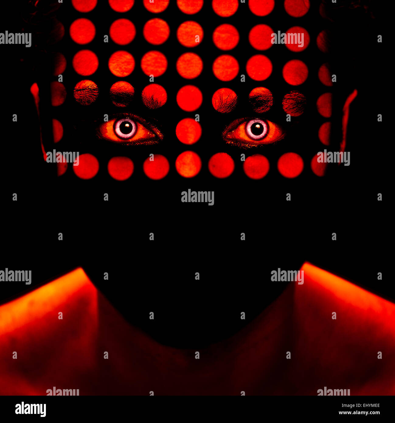Man's face with red dots - Stock Image