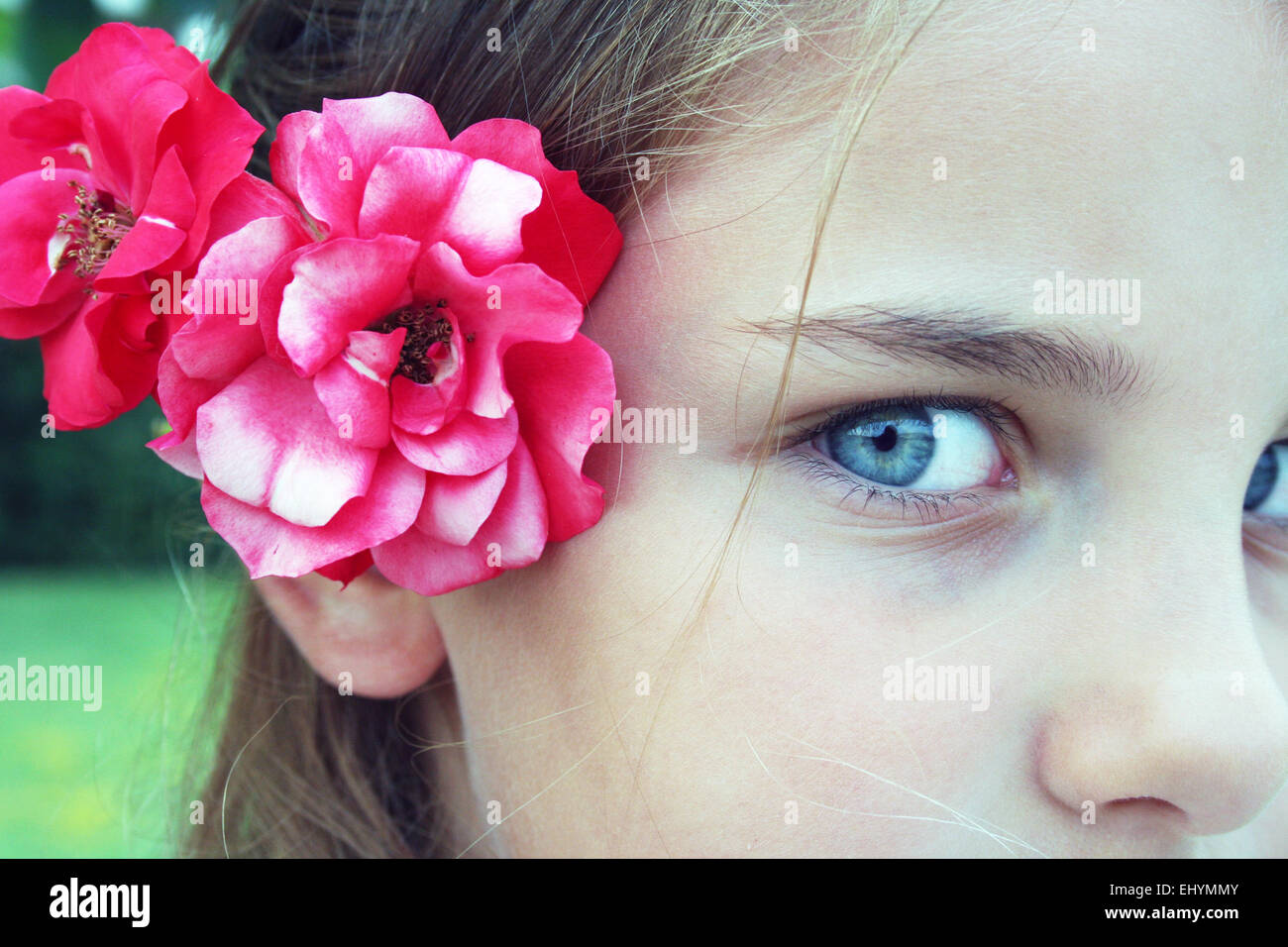Flower behind ear stock photos flower behind ear stock images alamy portrait of a girl with flowers behind her ear stock image izmirmasajfo