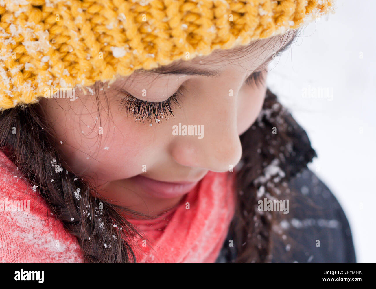 Close up portrait of  girl looking down - Stock Image