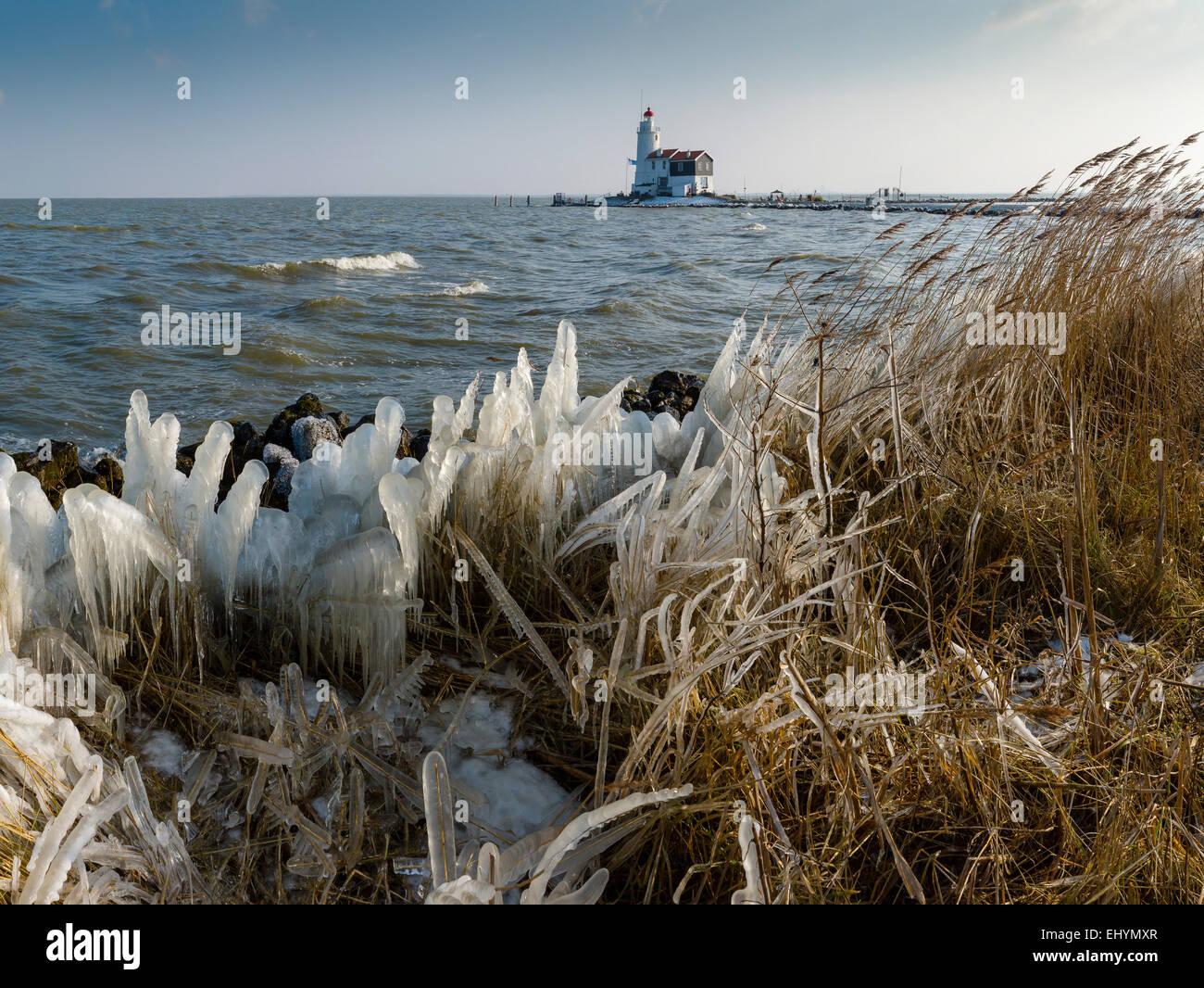 Netherlands, Holland, Europe, Marken, Lighthouse, Het Paard van Marken, landscape, water, winter, snow, ice, - Stock Image