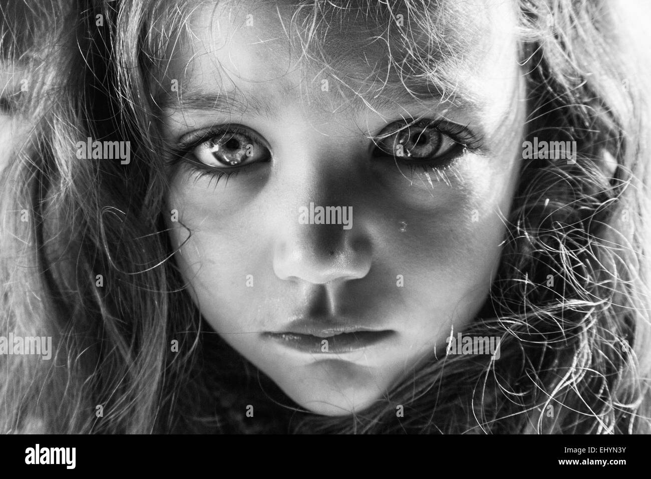 Portrait of a girl crying with a tear running down her face Stock Photo