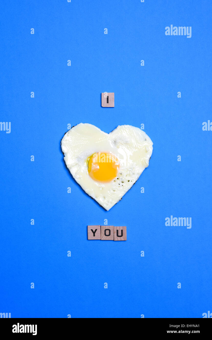 I love you written using an heart made with an egg Stock Photo