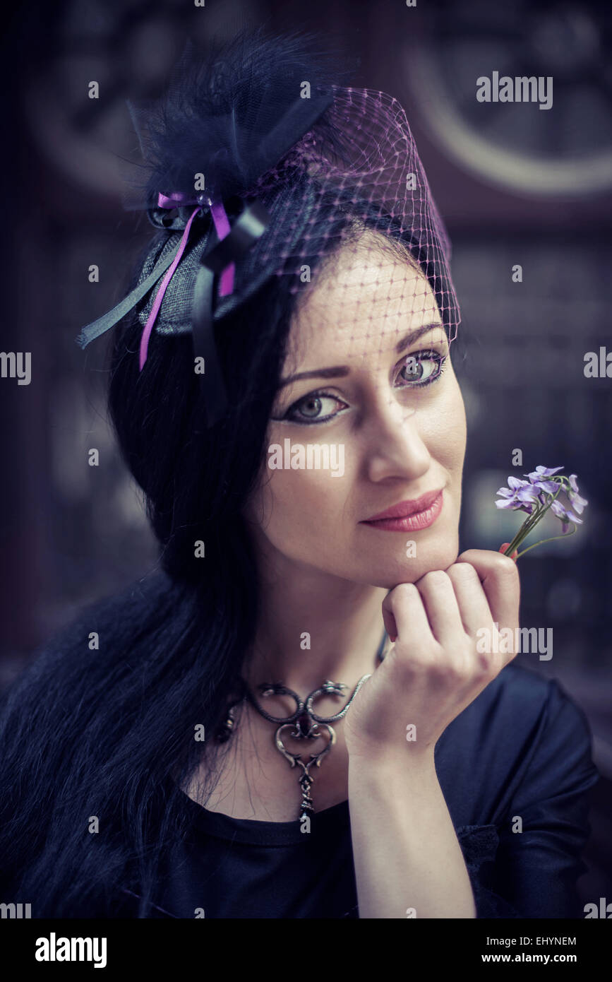 Portrait of a woman holding a flower Stock Photo