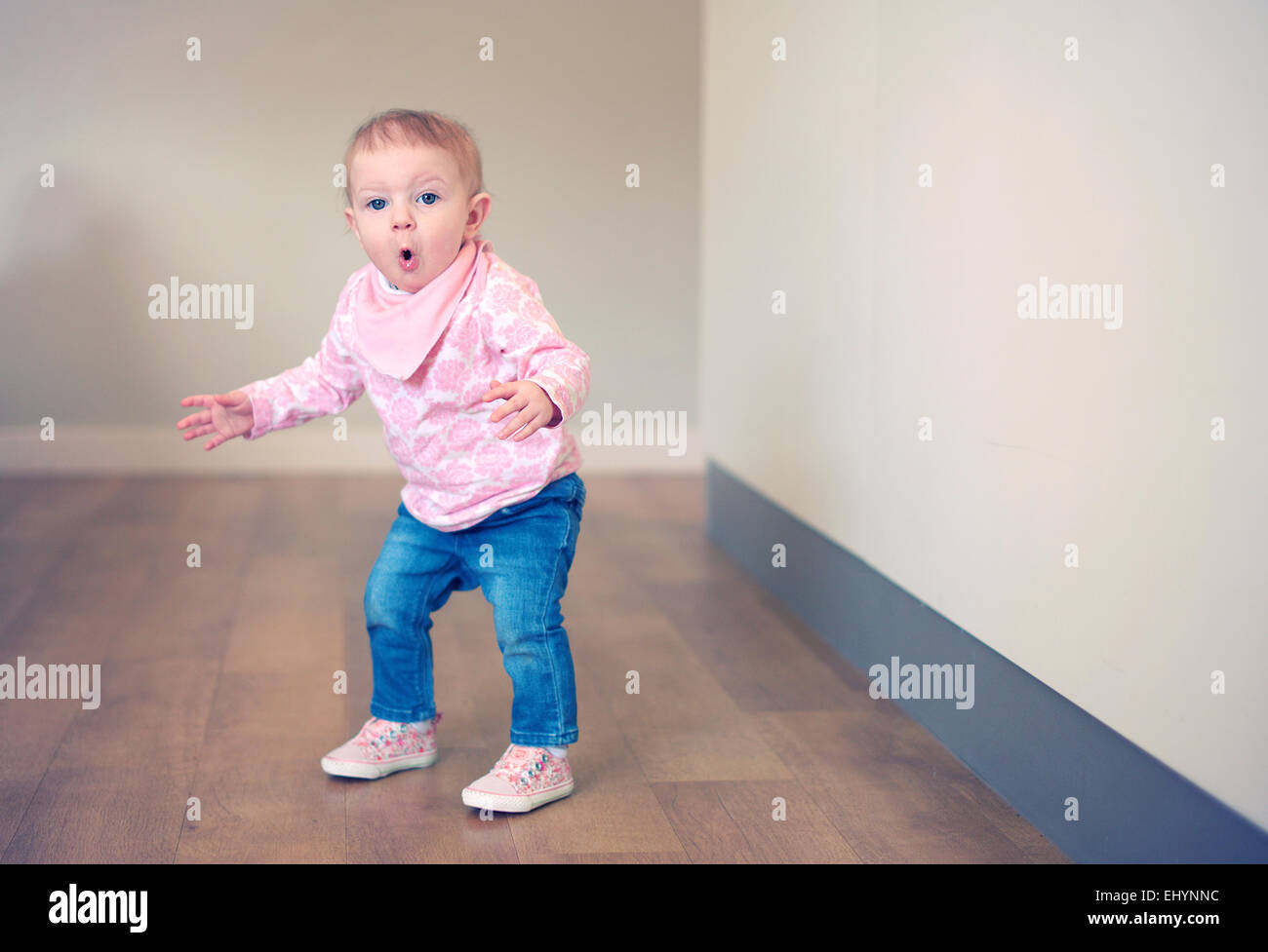 Baby girl learning to balance - Stock Image