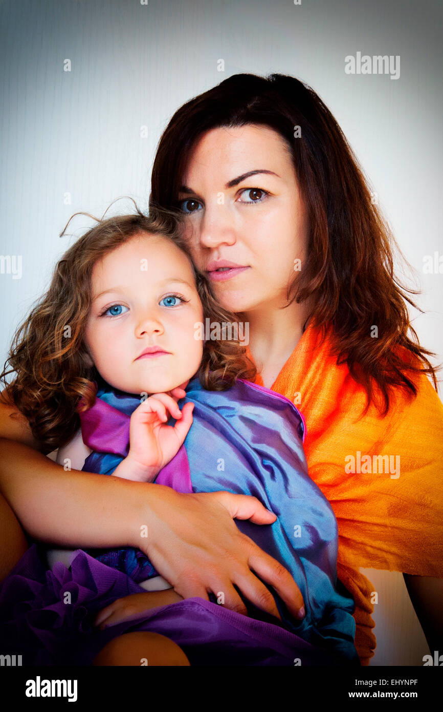 Mother sitting with her daughter - Stock Image