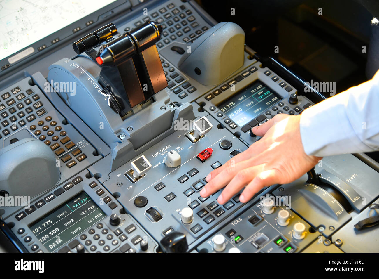 Cockpit with hand on the switch, control unit, Airbus A 350 900 XWB, Munich Airport 'Franz Josef Strauss', - Stock Image