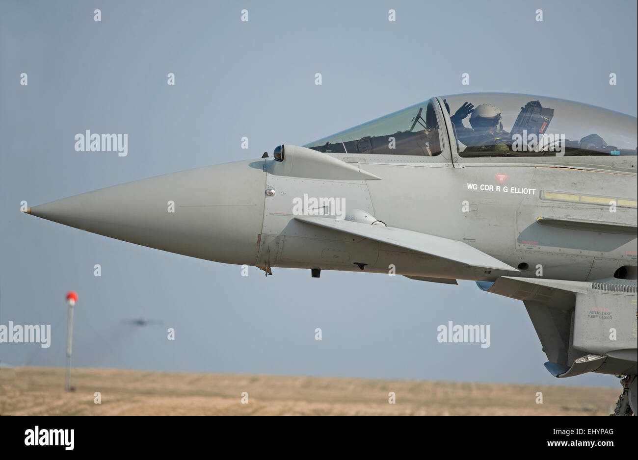 A friendly wave from this Eurofighter FRG4 Pilot as he taxies towards the 05 runway prior to take off.  SCO 9653. - Stock Image