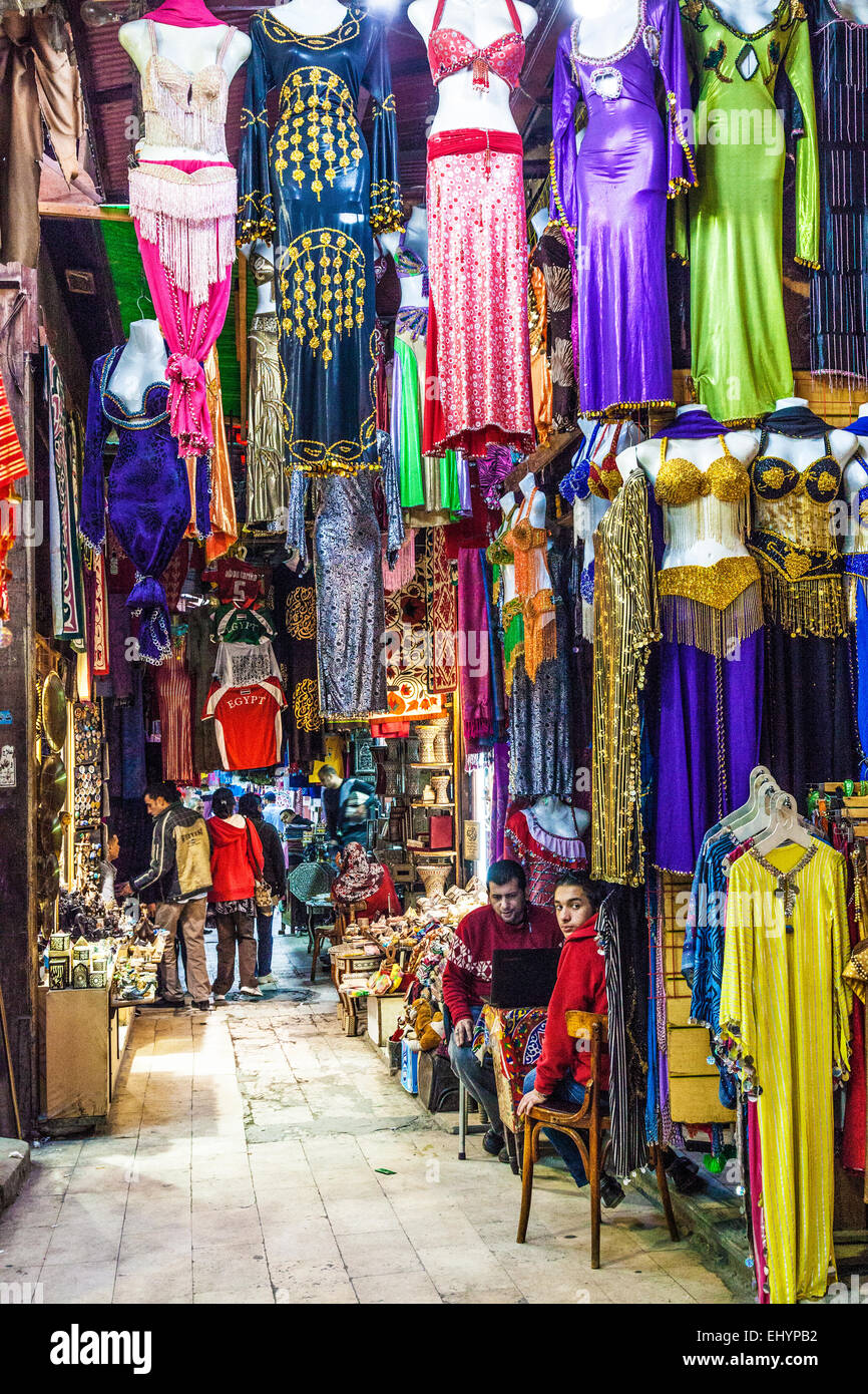 Colourful clothing in the Khan el-Khalili souk in Cairo. - Stock Image
