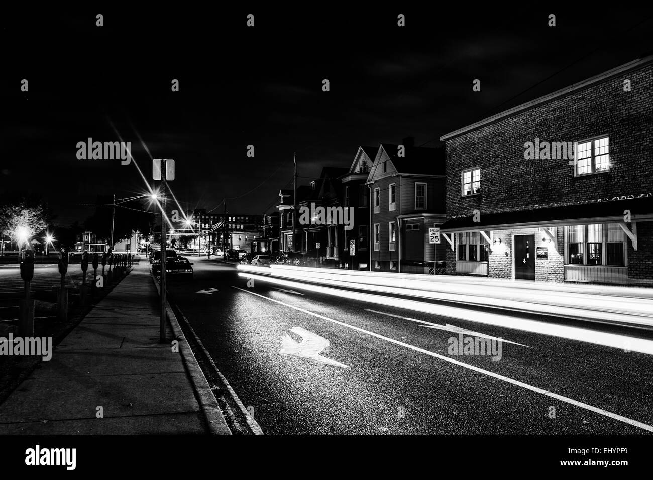 Light trails on a street at night in Hanover, Pennsylvania. - Stock Image