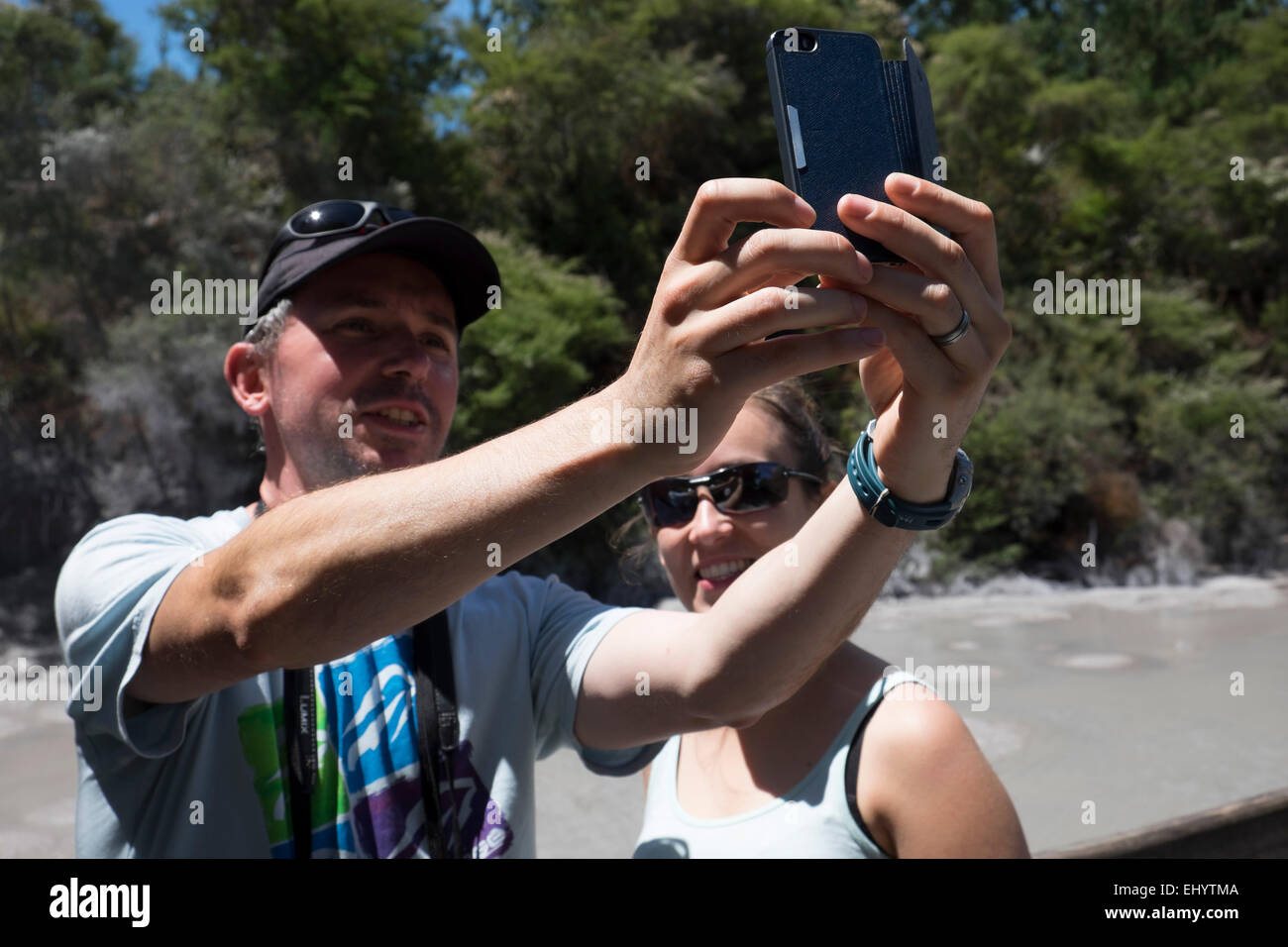 Broter and siser making a selfie with cell phone - Stock Image