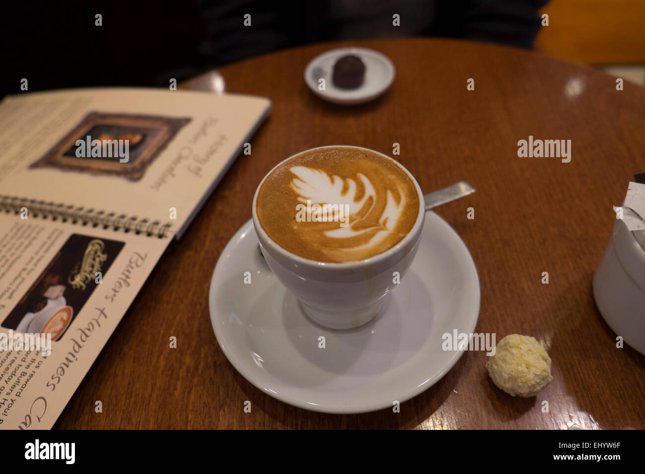 Flat white coffee with New Zealand nationalicon, Silver fern or Rosetta Artistic design in froth - Stock Image