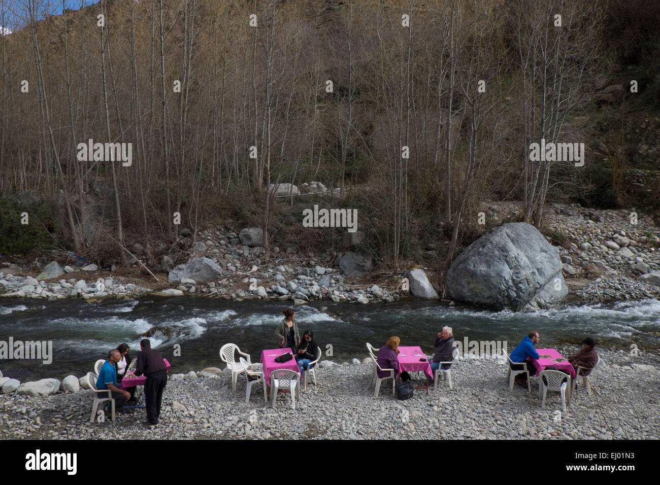 Tourists having lunch, Setti Fatma village, Ourika Valley, Atlas Mountains, Morocco, North Africa - Stock Image