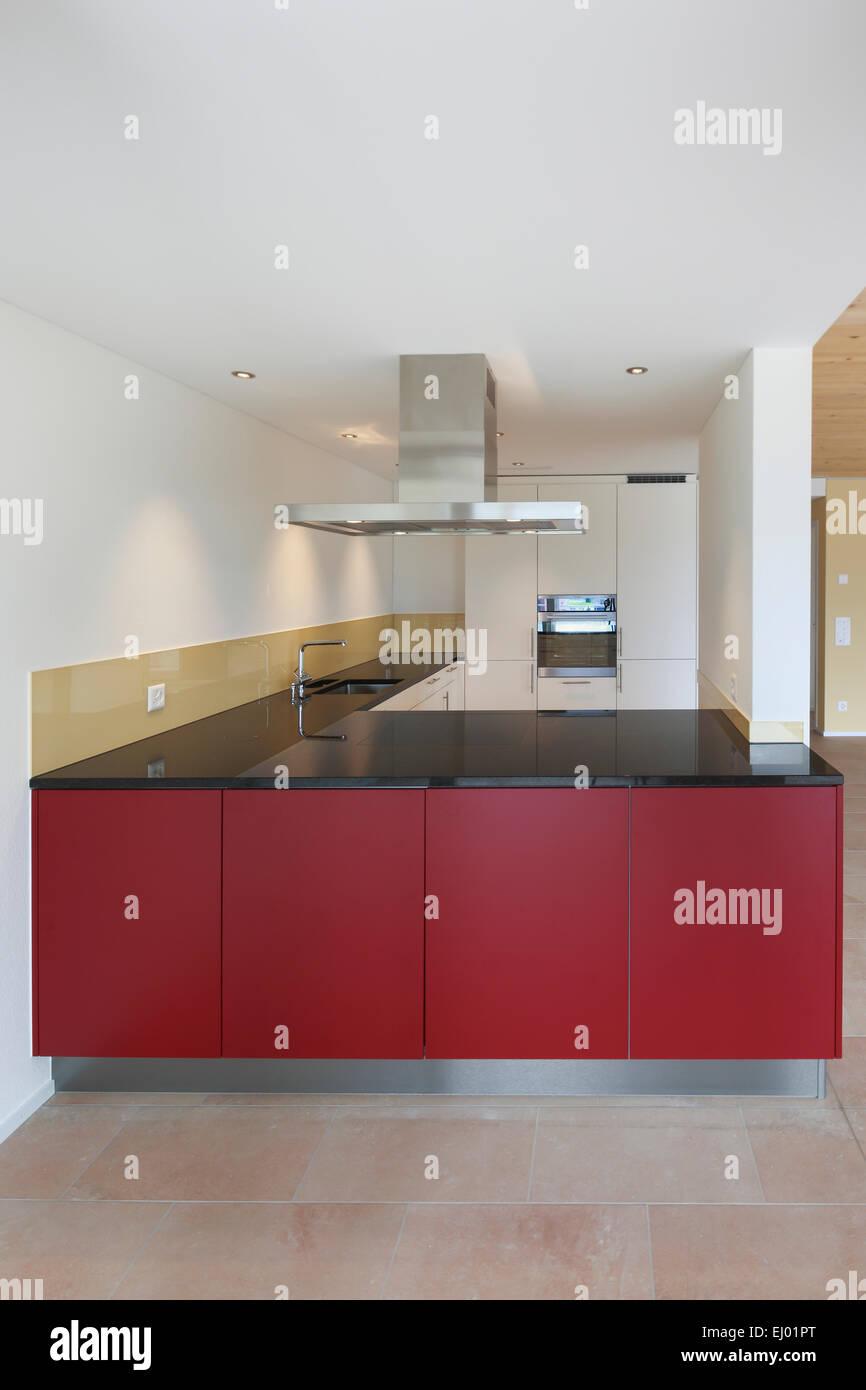 Architecture, chrome steel, house, home, interior, kitchen, Switzerland, apartment, red, modern, - Stock Image