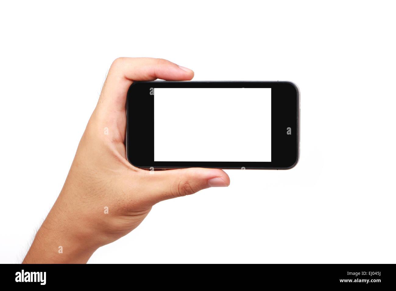Hand holding phone isolated on white background. - Stock Image