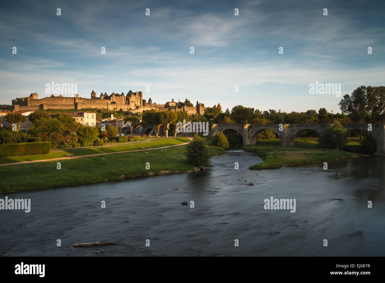 The fortified Cite de Carcassonne by the Aude River, Aude department, Languedoc-Roussillon region, France, Europe. - Stock Image