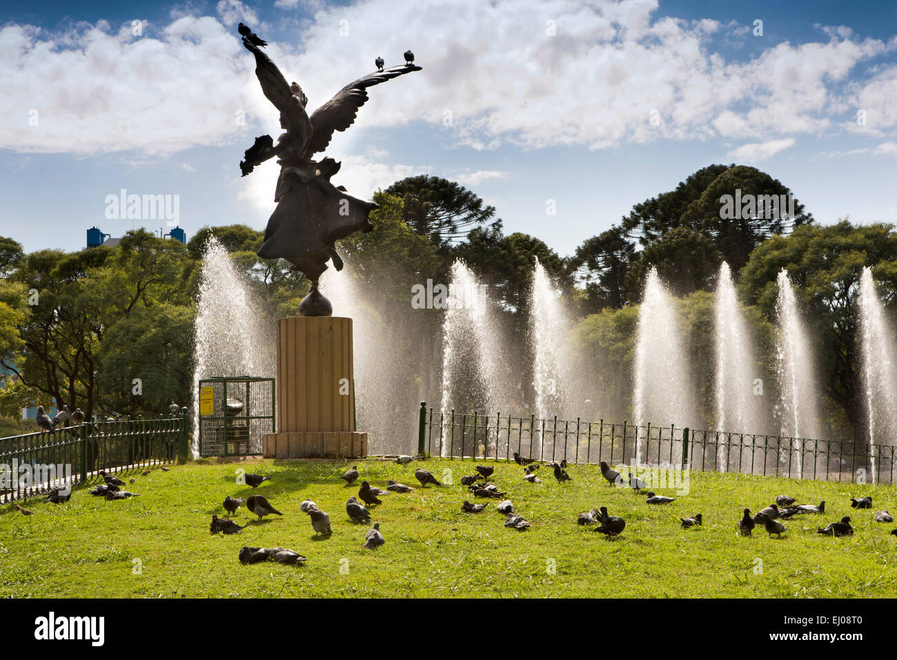 Argentina, Buenos Aires, Cabalito, Parque Centenario, Centenary Park, pigeons around Angel statue overlooking lake - Stock Image