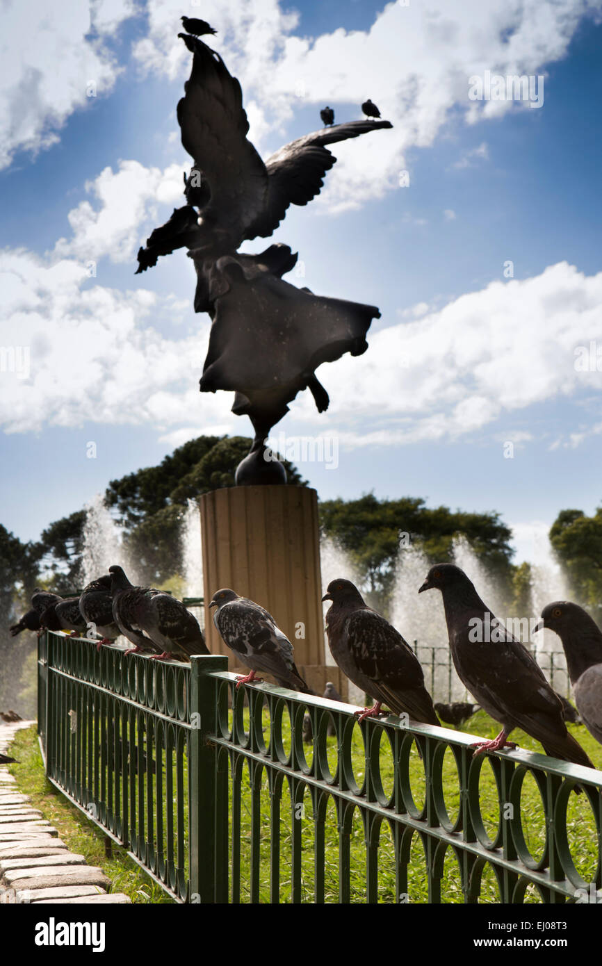 Argentina, Buenos Aires, Cabalito, Parque Centenario, Centenary Park, pigeons in railings around Angel statue overlooking - Stock Image