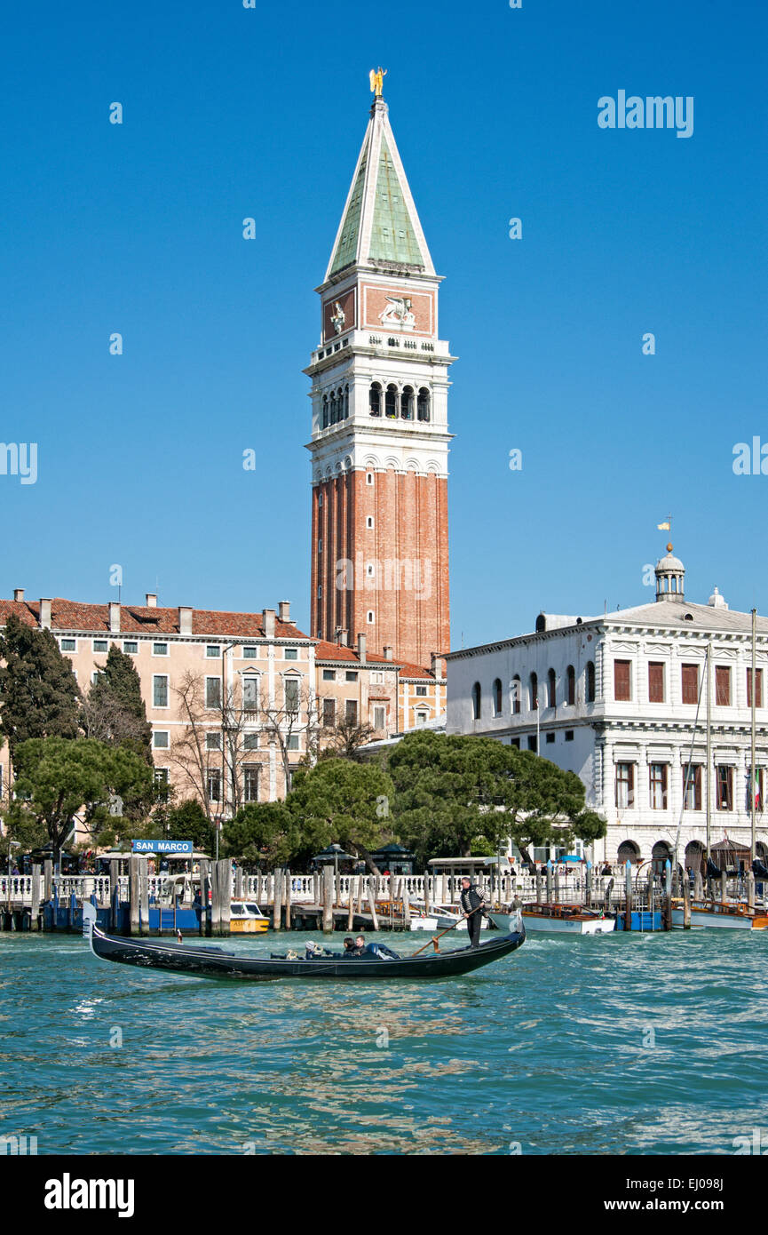 Gondola on the Grand Canal with San Marco Campanile, the bell tower. - Stock Image