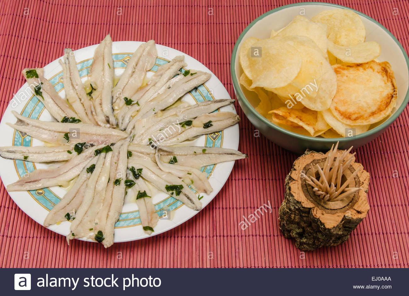 Raw anchovies with garlic, oil and vinegar. Boquerones en vinagre. - Stock Image