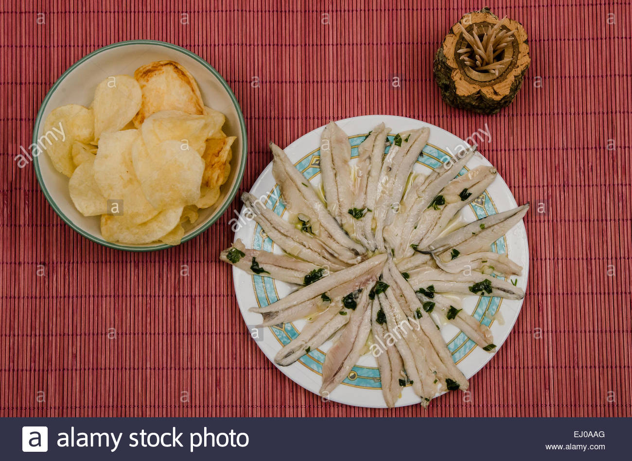 Anchovies in vinegar and fried potatoes. Boquerones en vinagre. Typical spanish appetizer - Stock Image