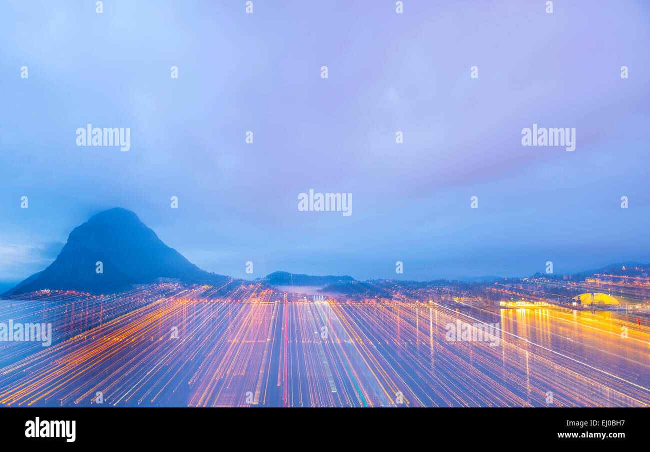 Lugano and lake Lugano with mountain and colorful sky in blue hour in Ticino, Switzerland, Europe, . Stock Photo