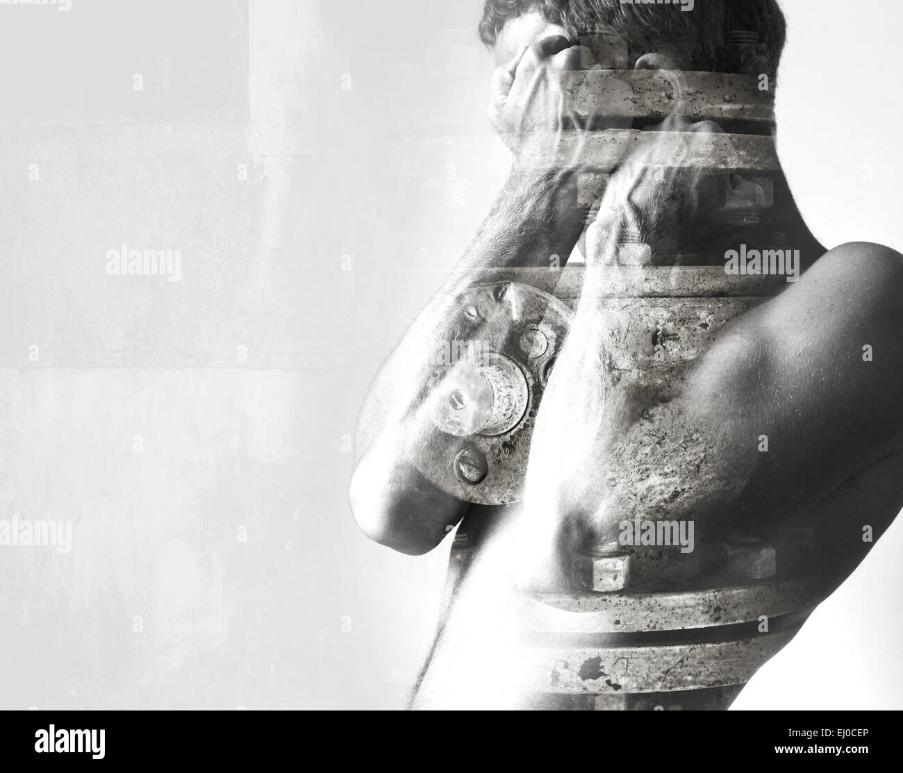 Double exposure abstract conceptual photo collage, man hides behind his strong blocking hands and industrial details - Stock Image