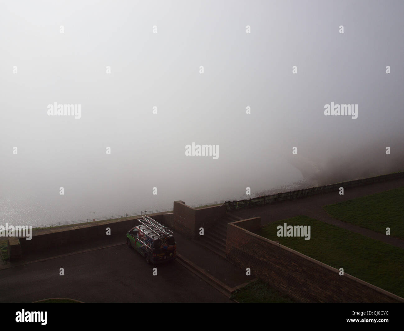 Newcastle Upon Tyne, UK. 19th March, 2015. A slight cool breeze in the air, rolling a heavy fog bank over and enshrouding - Stock Image