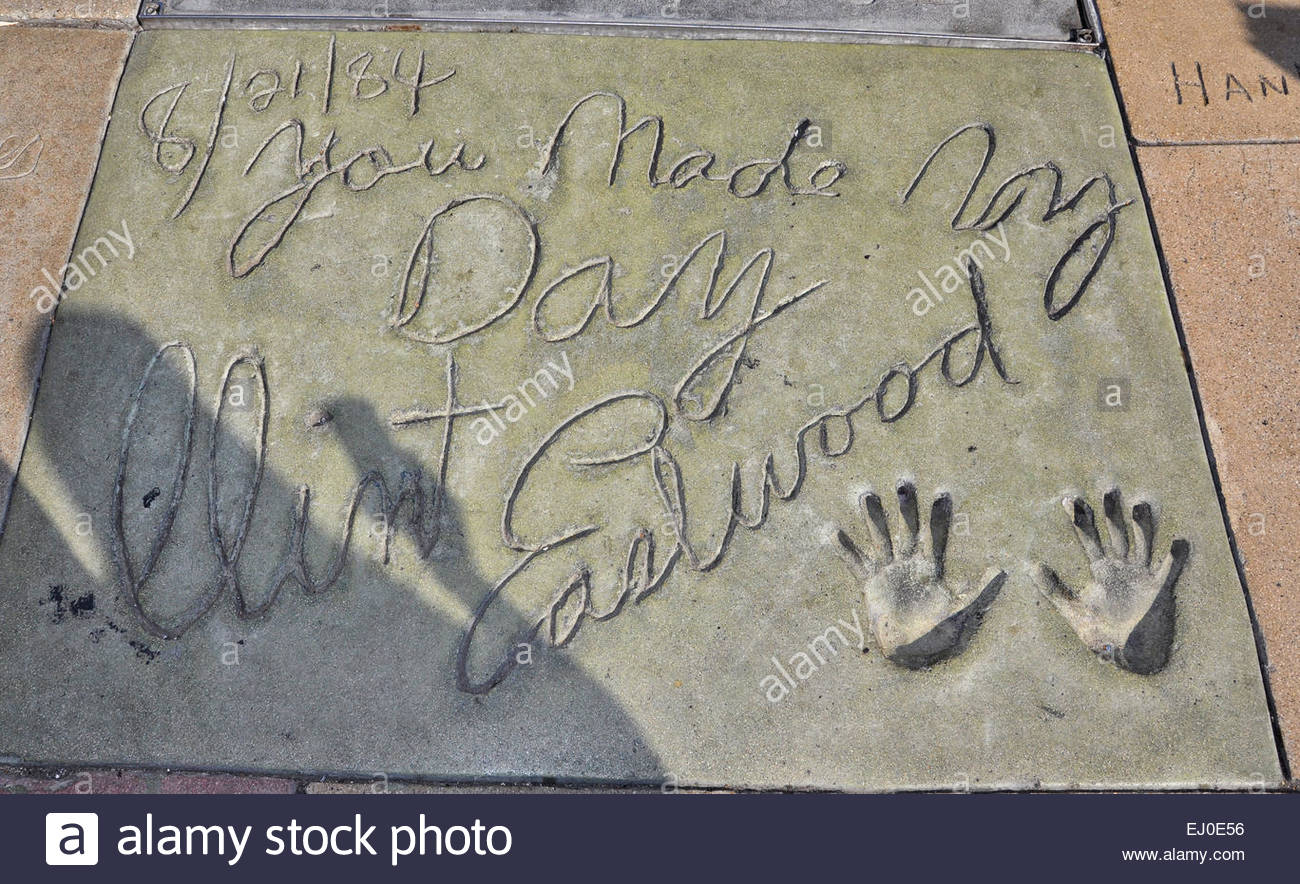 The hand prints of Clint Eastwood with his signatures on Hollywood Boulevard in Los Angeles, California, USA. - Stock Image