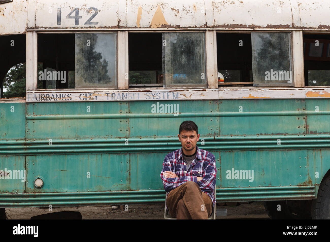 A hiker by bus 142, where Christopher McCandless was found dead, by the  Stampede Trail, near Denali National Park, Alaska, USA.