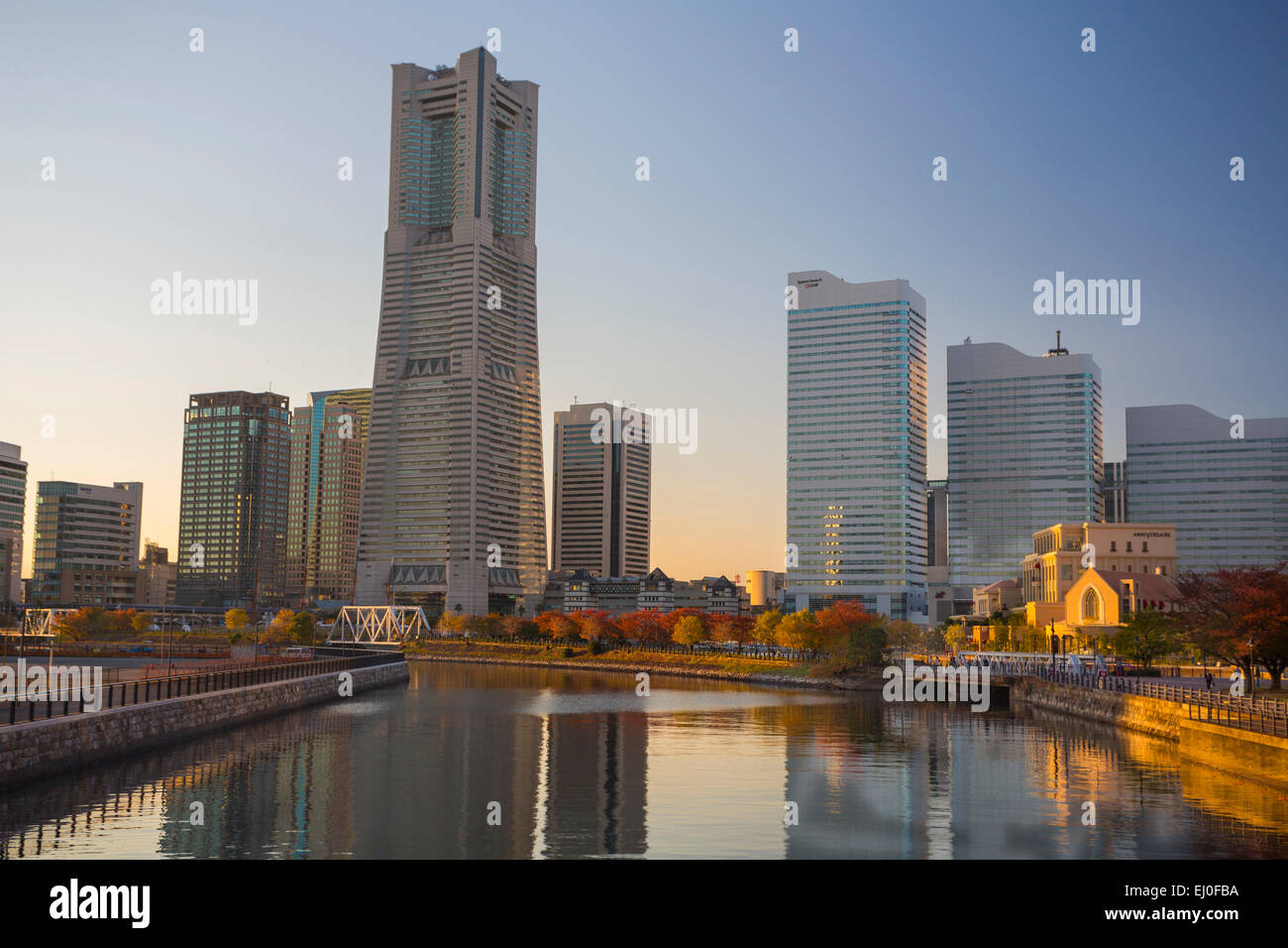 Building, Japan, Asia, Landmark, Yokohama, City, architecture, canal, reflection, skyline, evening, warm - Stock Image