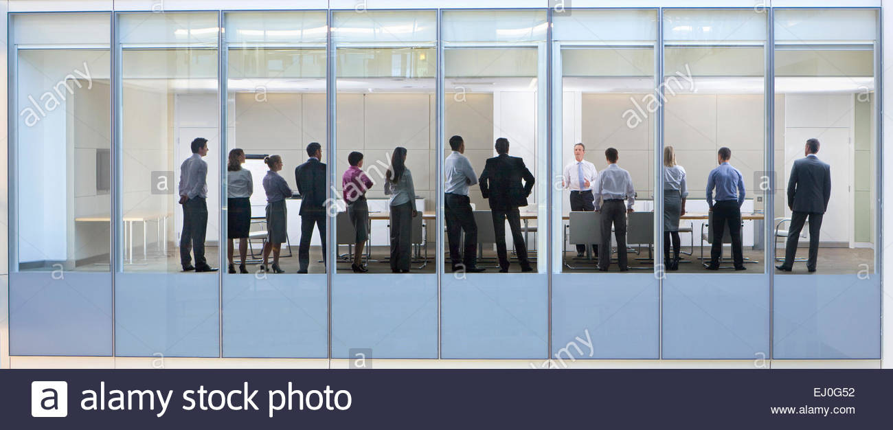 View Through Window Of People Standing In Business