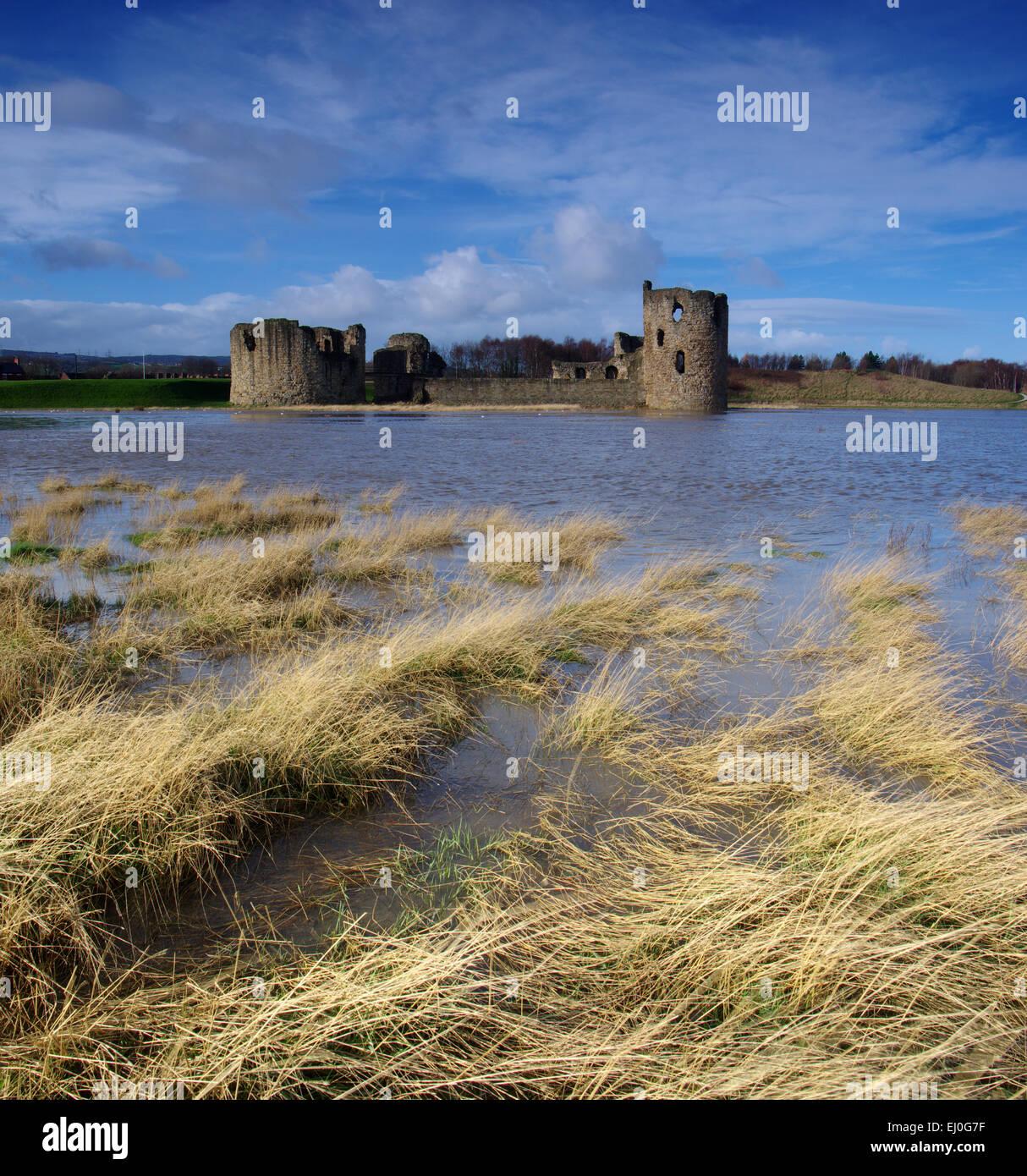 Flint Castle, high tide. - Stock Image