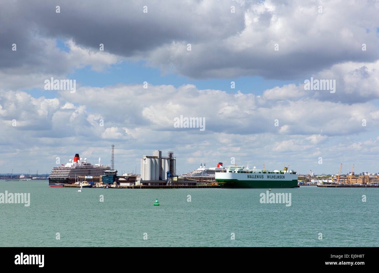 Southampton Docks With Big Cruise Ship And Cargo Vessel On Calm Summer Day With Fine Weather Blue Sky And White Clouds