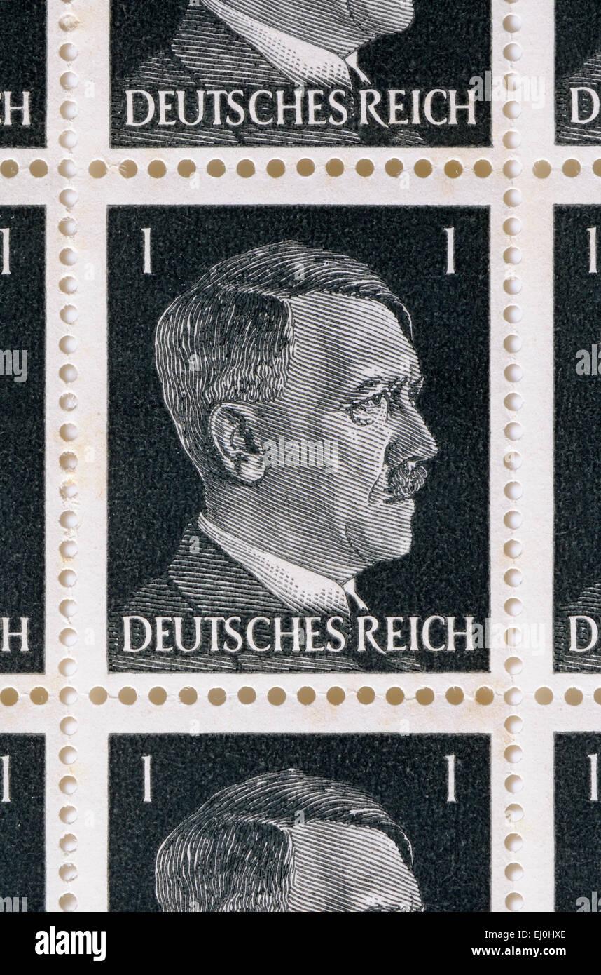 German 1pf stamp of the Deutsches Reich showing Hitler's portrait - Stock Image