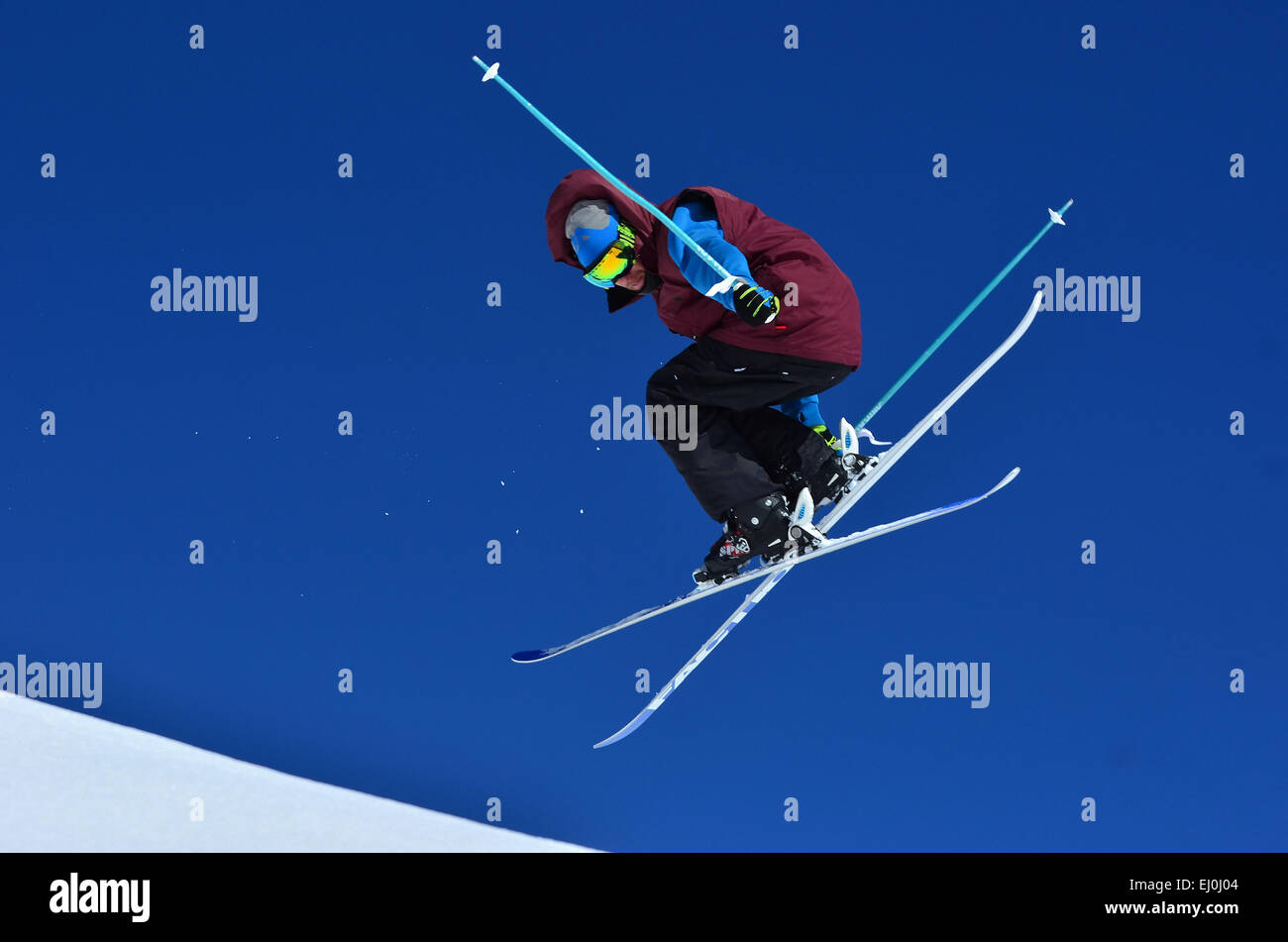 VERBIER, SWITZERLAND - FEBRUARY 21: Freestyle skier peforming a grab and spin stunt:   February 21, 2014 in Verbier, - Stock Image
