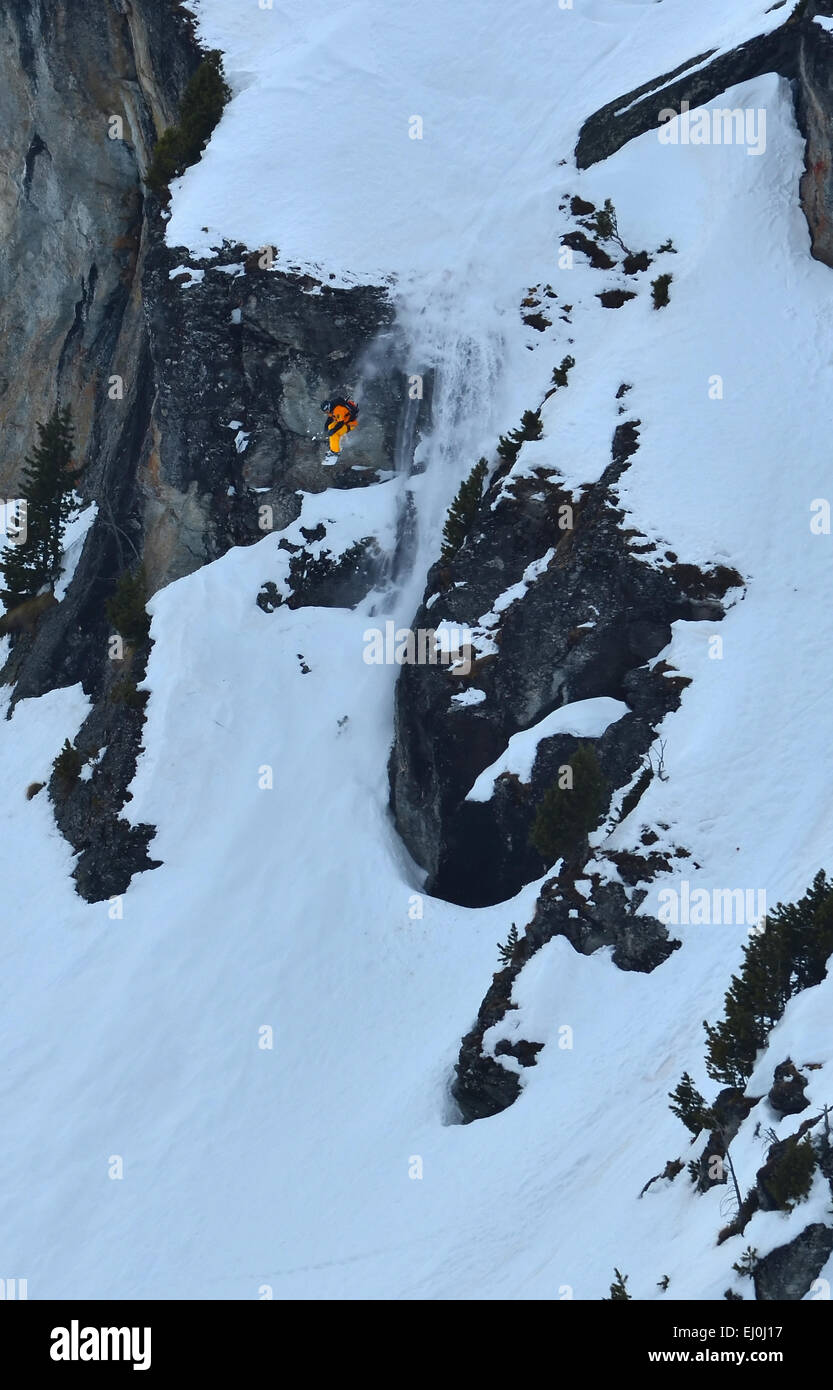 NENDAZ, SWITZERLAND - MARCH 15: 1st place Anouck Mouthon (FRA) jumping off a cliff in the Nendaz Freeride snowboard - Stock Image