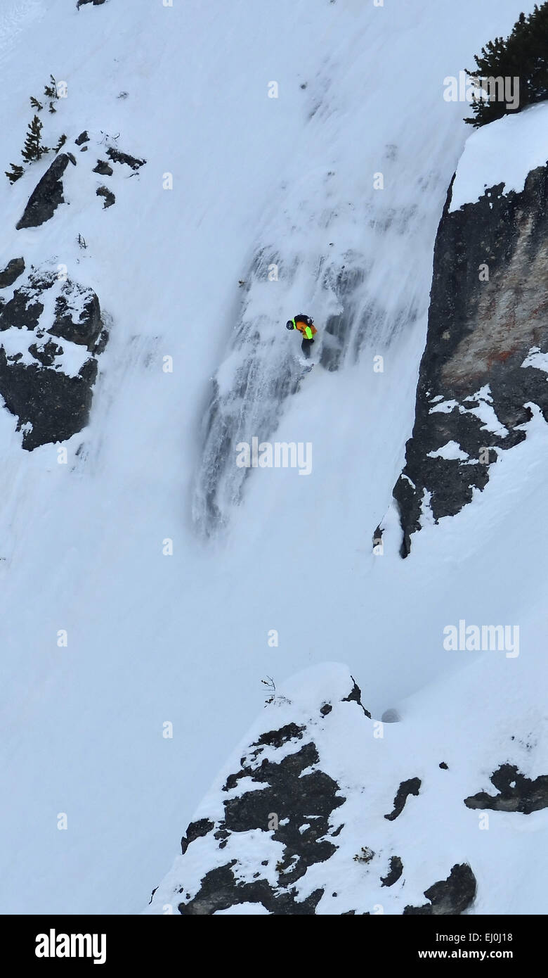NENDAZ, SWITZERLAND - MARCH 15: 1st place Sara HULTMAN (SWE) rides down an small avalanche at the Nendaz Freeride - Stock Image