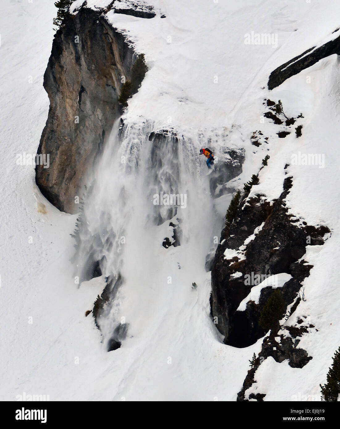 NENDAZ, SWITZERLAND - MARCH 15: 3rd place Chris CHARLET (SUI) over a cliff in the Nendaz Freeride snowboard  Finals: Stock Photo