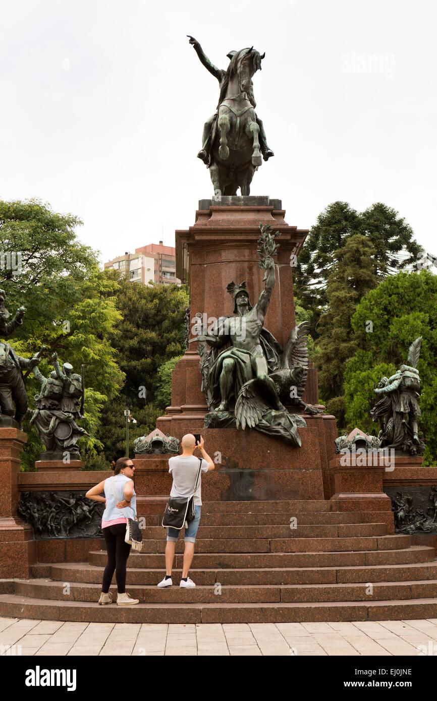 Argentina, Buenos Aires, Retiro, Plaza San Martin, tourists taking photograph of monument to General San Martin - Stock Image