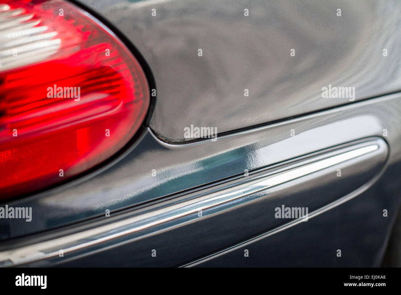 Close up detail of the rear end of a automobile. - Stock Image