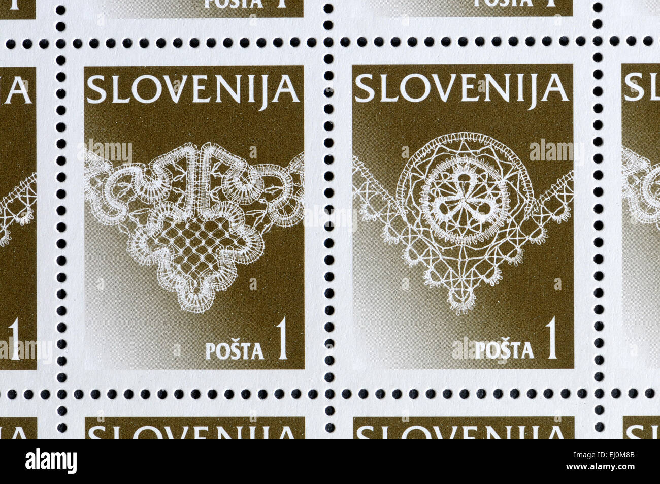 Slovenian postage stams showing Idrijan Lace - traditional craft in Idria, Slovenia. In se-tenant pairs Stock Photo