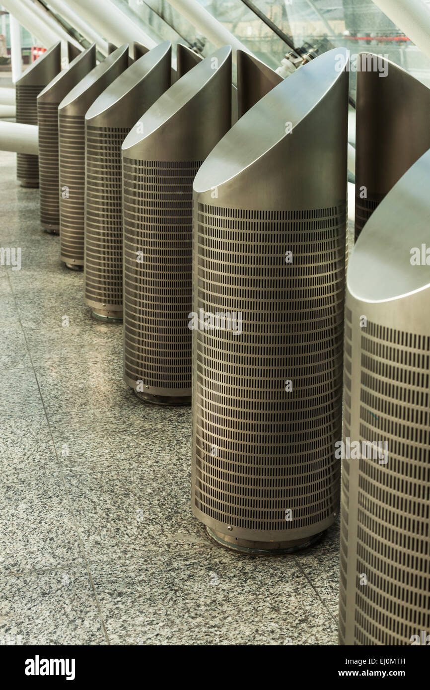 Metal columns housing air conditioning vents - Stock Image