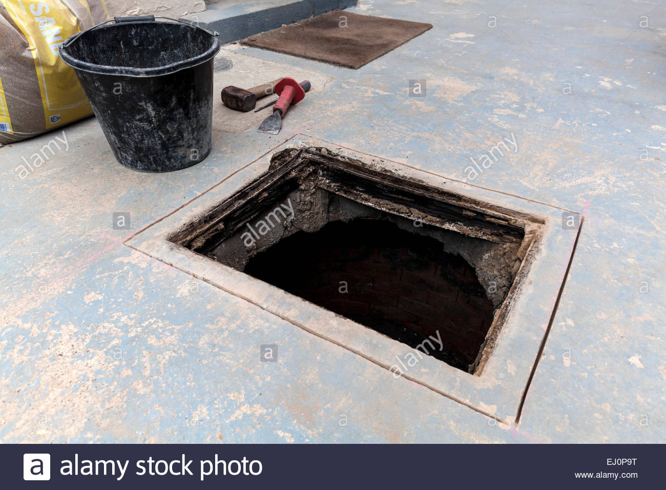 Cutting and replacing manhole cover frame - Stock Image